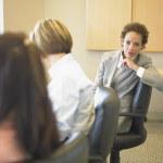 Portrait of businesswoman in meeting — Stock Photo