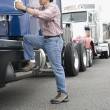 Man boarding truck — Stock Photo