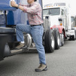 Man boarding truck — Stock Photo #13235104