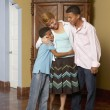 Hispanic mother and sons hugging — Stock Photo #13235126
