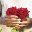 Stock Photo: Midsection of mholding roses