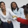 African family exchanging gifts at Christmas — Stock Photo