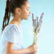Profile of girl holding flowers — Stock Photo