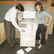 Businesspeople trying to use copy machine — Stock Photo