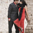 Hispanic couple in tango outfits — Stock Photo