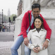 Asian couple hugging and smiling in London — Stock Photo