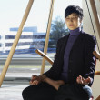 Asian businesswoman meditating — Stock Photo