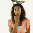 Young woman balancing a shoe on her head — Stock Photo