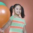 Portrait of young girl holding balloons — Stock Photo #13235390