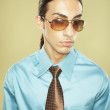 Middle Eastern businessman wearing sunglasses — Stock Photo