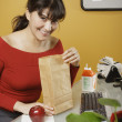 Happy businesswoman with lunch bag — Stock Photo