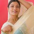 Studio shot of Indian woman in traditional clothing — Stock Photo