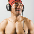 Asian man listening to headphones — Stock Photo