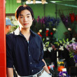 Stock Photo: Young min flower shop