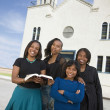 AfricAmericwomin front of church — Stok Fotoğraf #13235511