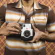 Young man holding a camera — Stock Photo