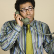 Foto Stock: Native Americbusinessmtalking on telephone