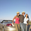 Portrait of friends leaning on car — Stock Photo