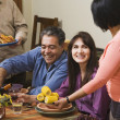 Middle-aged Hispanic couple at dinner party — Stock Photo #13235633