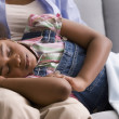 African American girl sleeping on mother - Stock Photo