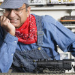 Stock Photo: Mdressed as conductor in hobby shop