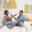 Couple taking lunch break while painting — Foto de Stock