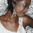 African woman wearing hands free device — Stock Photo