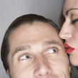 Woman kissing man on temple — Stock Photo