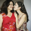 Stock Photo: Mother and daughter kissing