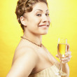 Portuguese woman holding glass of champagne — Stock Photo