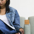 Young woman reading a magazine waiting in a waiting room — Stock Photo #13235746