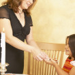 Hispanic mother and young daughter sharing desert — Stock Photo #13235747