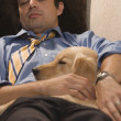 Dad after Work Asleep with Dog — Stock Photo #13235793