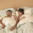 High angle view of couple asleep in bed — Stock Photo