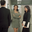 Stock Photo: Businesswomen admiring colleague in office space
