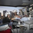 Doctors with patient in medical helicopter — ストック写真