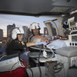 Doctors with patient in medical helicopter — Stockfoto