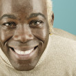Headshot of young man smiling broadly - Stock Photo