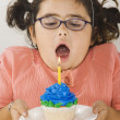 Young girl with birthday cupcake — Stock Photo
