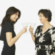 Stock Photo: Studio shot of Asian mother and adult daughter toasting