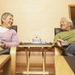 Senior Asian couple having tea — Stock Photo