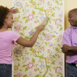 Couple hanging wallpaper — Stock Photo #13235909