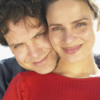 Stock Photo: Close up portrait of couple hugging