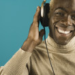 Portrait of man smiling with headset on — Stock Photo
