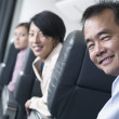Portrait of passengers on airplane — Stock Photo