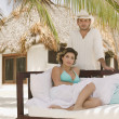Young man and woman in tropical resort — Stok fotoğraf