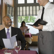 Man ordering in restaurant — Stock Photo