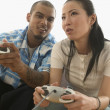 Couple playing video games — Stock Photo #13235973