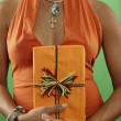 Stock Photo: Midsection of womwith wrapped gift