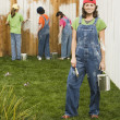 Mixed Race family painting fence — Stock Photo #13236026